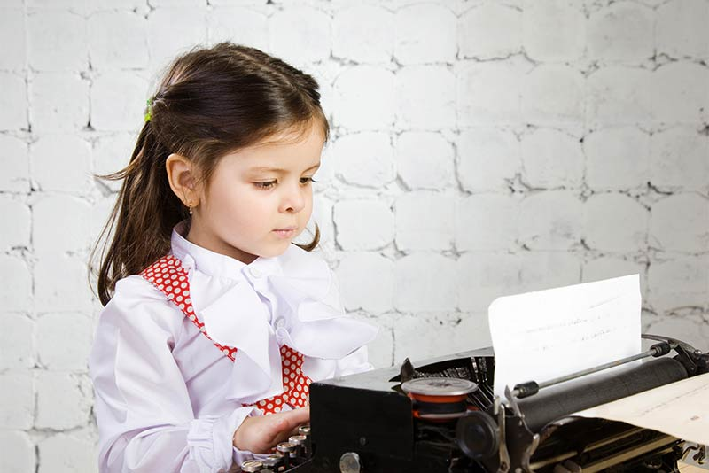 Little girl with typewriter.